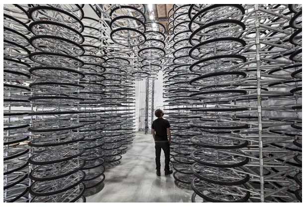 "Ai Weiwei's ""Stacked"", created out of 760 symbolic Forever Bicycles - the mostly widely used bicycles in China - is one of the many installations presented at Art Basel Unlimited"