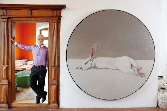 Uli Sigg next to the painting «Moon Rabbit» by Shao Fan © Sigg Collection Photo: Karl-Heinz Hug